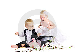 Girl And Boy In A Dress The Bride And Groom Royalty Free Stock Photo - Image: 23769045