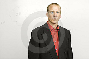Businessman with writing board Stock Photo