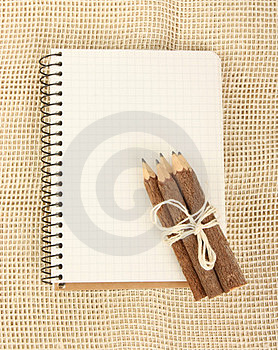 Notebook And Pencils On Burlap Royalty Free Stock Photos - Image: 23835908