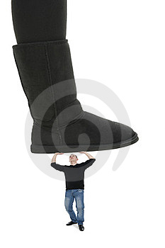 Man Under The Woman's Sole Royalty Free Stock Photo - Image: 23869065