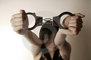 Asian girl holding handcuffs Stock Photography