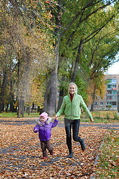Woman  With Her Daughter In The Autumn Park Stock Photography - Image: 23931252