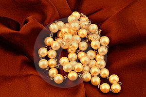 Neckless On Red Velvet Royalty Free Stock Photography - Image: 23933157