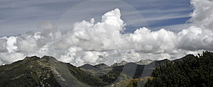 Mountain Peaks And Clouded Sky Panorama Royalty Free Stock Photo - Image: 23938215