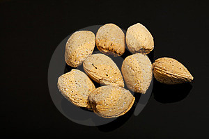 Almonds On Black Background Stock Photos - Image: 23963903