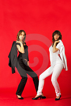 Pretty Sisters Twins In White And Black Costumes Stock Photo - Image: 23995890
