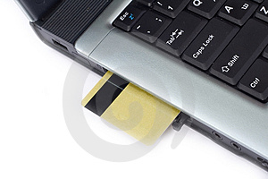 Credit Card Inserted In Laptop Stock Photo - Image: 2400960
