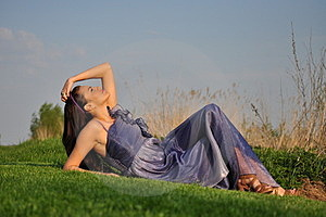 Beautiful Girl Laying On A Grass Royalty Free Stock Image - Image: 24007526