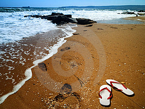 Sea Surf With Footprint Over Sand Royalty Free Stock Images - Image: 24014199
