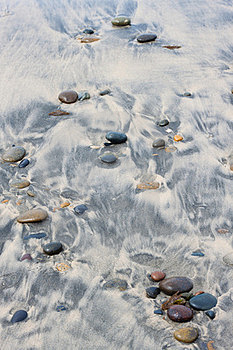 Pebble On Sandy Beach Royalty Free Stock Photos - Image: 24017358