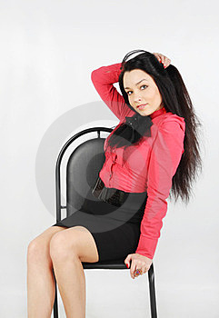 Girl Sits On Chair And Touches Her Hair Royalty Free Stock Photo - Image: 24020055