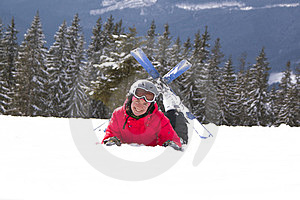 Girl Skier Lie On The Snow Royalty Free Stock Image - Image: 24024066