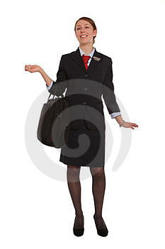 Flight Attendant Walking To Her Flight Royalty Free Stock Photo - Image: 24110475