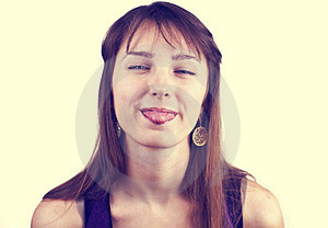 Portrait Of Young Pretty Woman With Her Tongue Out Royalty Free Stock Image - Image: 24130506