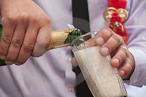 Hands Pour Champagne Stock Photo - Image: 24160010