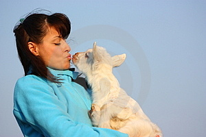 Woman Kissing A Baby Goat Royalty Free Stock Photo - Image: 24205965