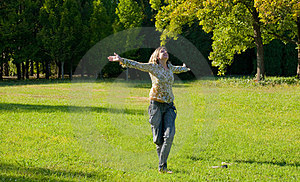 Carefree Adorable Girl With Arms Out In Field. Royalty Free Stock Photography - Image: 24206687