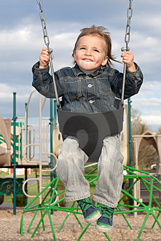 Young Boy Swinging Royalty Free Stock Images - Image: 24269809