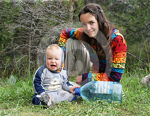 Mother And Baby On The Nature Royalty Free Stock Photo - Image: 24297575