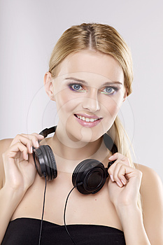 Beautiful Girl Is Listen To The Music Royalty Free Stock Image - Image: 24307006