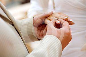 Putting A Wedding Ring On Bride's Finger Royalty Free Stock Photography - Image: 24308647
