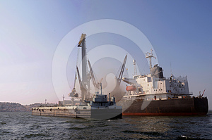 Cranes Inside Big Cargo Ship And Barge - Floating Royalty Free Stock Photos - Image: 24347888