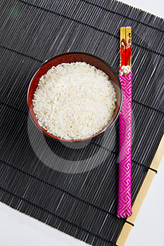 Bowl Of Rice With Chopsticks Royalty Free Stock Image - Image: 24353026