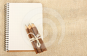 Notebook And Pencils On Burlap Royalty Free Stock Image - Image: 24368596