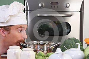 Chef Strange Looking At Pot Stock Photo - Image: 24378220