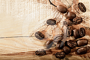 Coffee Beans Over Wooden Desk Royalty Free Stock Image - Image: 24385746
