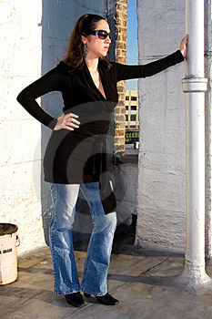 Woman Leaning Against A Pole Royalty Free Stock Image - Image: 2446036