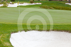 Golf Green And Flag Pin Surrounded By Sand Traps Royalty Free Stock Image - Image: 24414046