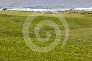 Golf Course Greens Leading To Hole By The Ocean Royalty Free Stock Photo - Image: 24450545