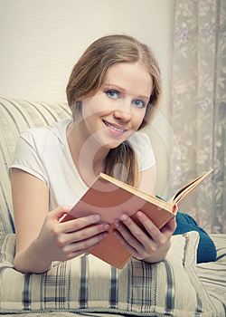 Pretty Girl Reading A Book Lying On The Sofa Royalty Free Stock Images - Image: 24469619