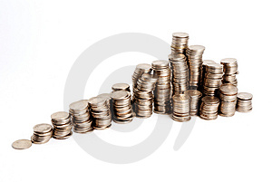 Increasing pyramid of coins Royalty Free Stock Image