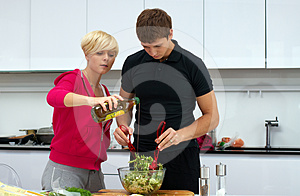 Lovely Couple Making A Salad Royalty Free Stock Photography - Image: 24508107