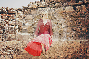 Girl In Red Sitting On The Wall Royalty Free Stock Photos - Image: 24510658