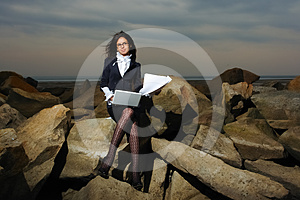 Business Lady Sitting On The Rocks By The Sea, Aga Royalty Free Stock Photos - Image: 24526808