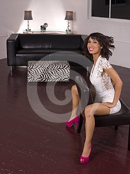 Young Woman Straddles The Chair Living Room Stock Photo - Image: 24526840