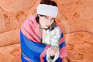 Girl Thermometer On The Couch Stock Image - Image: 24538571