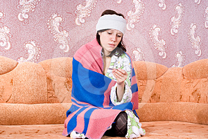 Thermometer Girl In A Bathrobe On The Couch Royalty Free Stock Photos - Image: 24538588