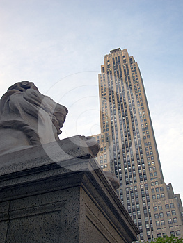 Lion Sculpture And Skyscraper Royalty Free Stock Photos - Image: 24550328