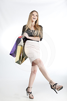 Girl With Shopping Laughs Royalty Free Stock Image - Image: 24572436