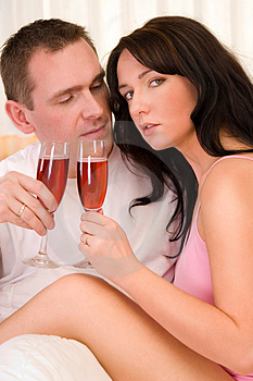 Couple In Bed Drinking Wine Royalty Free Stock Photo