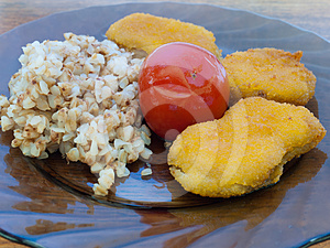 Buckwheat Porridge With Chicken Nuggets And Tomato Royalty Free Stock Photography - Image: 24603607