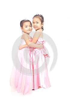 Two Asian Girls In Pink Dress Hugging Each Other Stock Photo - Image: 24641030