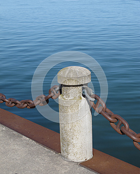 Post And Chain On A Pier Royalty Free Stock Photo - Image: 24686235
