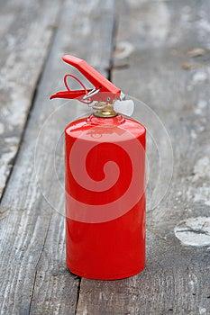 Extinguisher On The Wooden Sidewalk Royalty Free Stock Photos - Image: 24738608