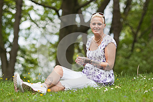 Beautiful Woman Sits In The Grass Stock Photos - Image: 24743643