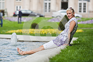 Young Woman Relaxes Pondside Royalty Free Stock Photo - Image: 24744065